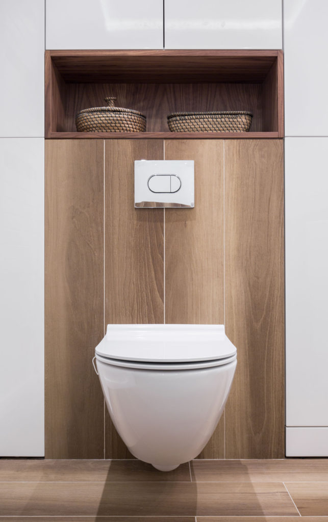 41635825 - restroom with white toilet on wooden panel